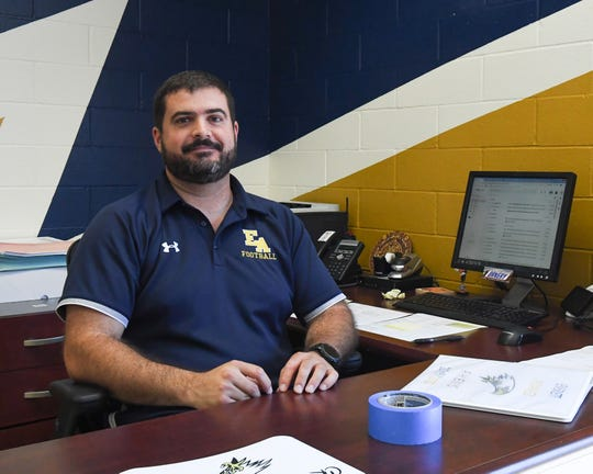 Brian Vazquez in his recently re-painted office as Athletic Director.