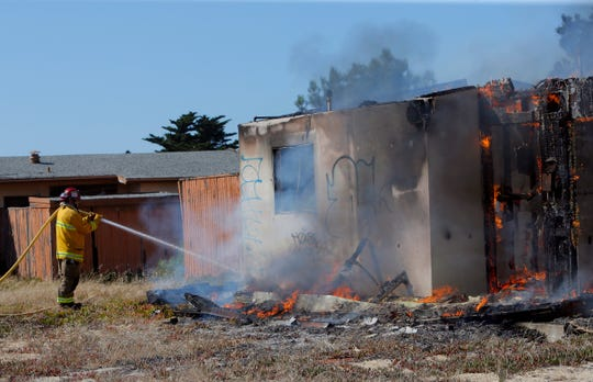 Marina firefighters contained a vacant duplex fire in Fort Ord Wednesday afternoon after the flames billowed smoke that left Salinas hazy and confused as to where the smoke was coming from.