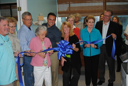 Kathleen Harman (center) cuts a ribbon at a ceremony in 2013 at the Ocean City Hotel-Motel Restaurant Association office.
