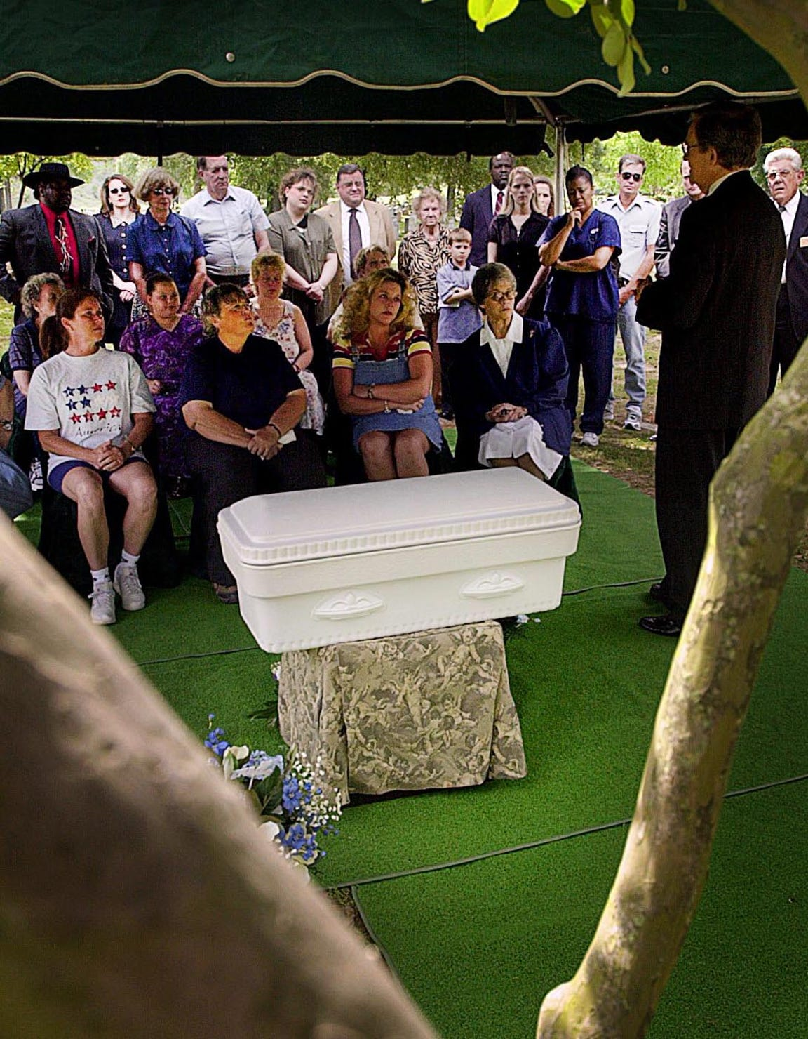 Several dozen people gathered Wednesday, April 24, 2002, at the funeral for a newborn child that was found dead three years ago. The child's parents were never identified.