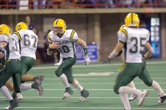 Aberdeen Roncalli quarterback Dan O'Keefe runs the ball at the state finals in Vermillion in 2006. Aberdeen Roncalli beat St. Thomas More for the state title.