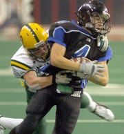 Jerry McNeary, Aberdeen Roncalli, pulls down Tanner Wince, St. Thomas More, as Wince tries to break away just yard from a touchdown in second quarter action of the Class 11B championship game in 2006.