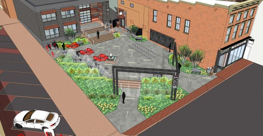 The outdoor plaza area of the Staunton Innovation Hub. The plaza looks out onto North Augusta Street.