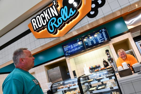 Owners Mark Frandle and Keith Sandborg talk about getting the new Rockin' Rolls location up and running Thursday, July 25, 2019, at Crossroads Center in St. Cloud.