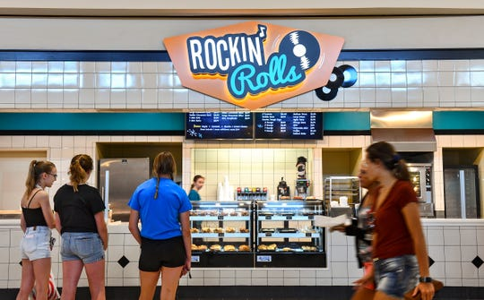 Shoppers walk past the new Rockin' Rolls location Thursday, July 25, 2019, at Crossroads Center in St. Cloud.