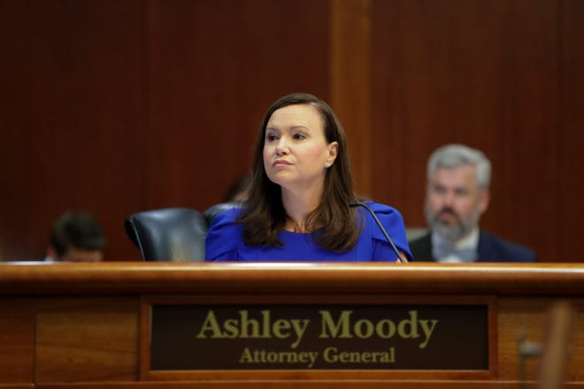 Attorney General Ashley Moody listens during a Florida Cabinet meeting.