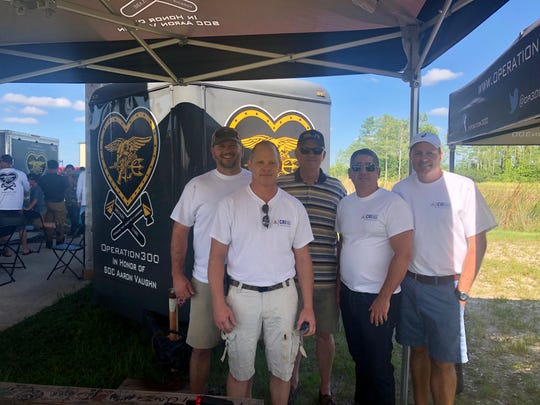 Team CRI members Michael Crook, Joe Risse, Michael Lewis, Michael Stevens, Chris Facka volunteer for Operation 300.
