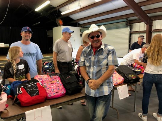 Jesse Zermeno (center), founder and president of Operation Hope, oversees the organization's 2018 school supplies giveaway in Fellsmere.
