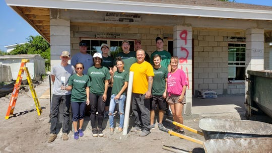 Employees of Caler, Donten, Levine, Cohen, Porter & Veil, P.A. in Stuart recently participated in a home build for Habitat for Humanity of Martin County. Volunteers from the CPA firm painted, installed windows and removed debris at the construction site. The volunteer team included, from left, back row, Jeff Platt, Nancy Gray, Martin Woods, Rick Gray, and Dustin Provenzano; front row, Daniel Boring, Cherry Meola, Anna Knox, Yinett Florentino, Juan Caban, Luke Mellone and Nancy Prywitowski.