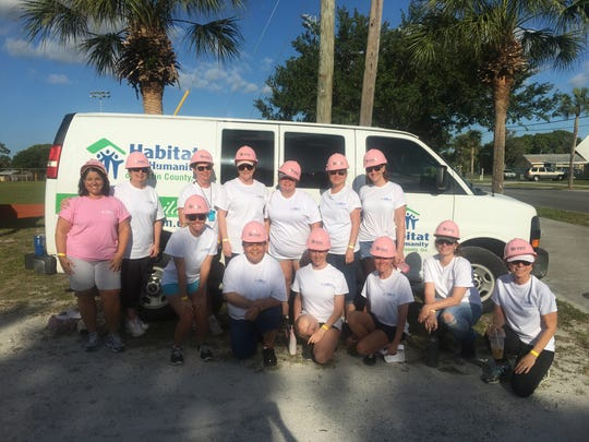 Team CRI members Joyce Ruggeri, Jamie Dunham, Karla George, April Hicks, Christy Anglim, Clarice Rieth, Kathy Miller, Cynthia Wilson, Stephanie Murray, Barbara Barbero, Danae Silver, Anita Brock, Morgan Murphy volunteer at the Martin County Habitat Women Build Day.