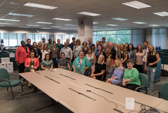 Employees at TCPalm/Treasure Coast Newspapers say farewell to The Stuart News building at 1939 S.E. Federal Highway (U.S. 1) on Wednesday, July 17, 2019, in Stuart. The building will be vacated to make way for the Martin County School District's new administration offices.