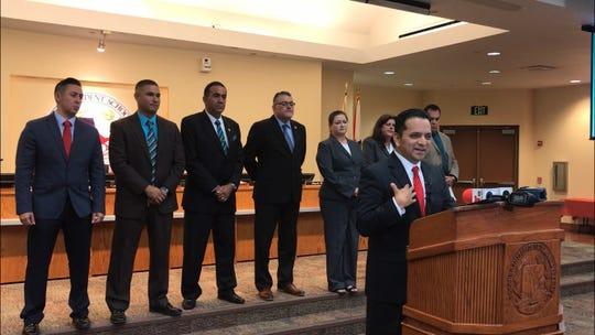 Socorro ISD Superintendent José Espinoza addresses media during a July 23, 2019 school board meeting as board trustees look on.