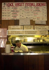 2000 Journal News archive photo, 2000:  For over 20 years the Traverson's Wooden Indian Restaurant in Nyack posted Nyack High School football scores.