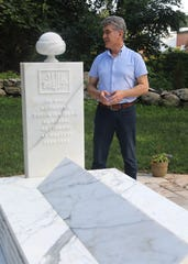 Sheikh Yurdaer Doganata at Jerrahi of America mosque stands near the burial plot of the late Tosun Bayrak in Chestnut Ridge on July 24, 2019. The village is working on a law to prohibit backyard burials.