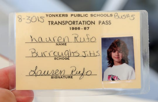 Lauren Rufo Stanco, who was bused to junior high school outside her neighborhood starting in 1986, shows her transportation pass July 24, 2019 in Yonkers.