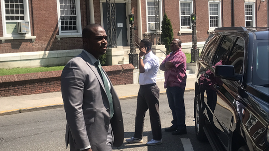 Richard Thomas, center, standing with Mount Vernon police Chief Ziadie and a detective on the mayor's security detail after arriving at City Hall on Thursday, July 25, 2019. Ziadie has ignored an order by Shawn Harris, appointed police commissioner by acting mayor Andre Wallace, to strip Thomas of the security because the city council no longer recognizes Thomas as mayor