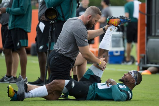Eagles' DeSean Jackson (10) stretches during training camp Thursday at the NovaCare Complex.