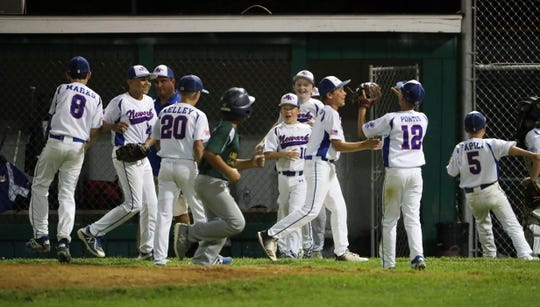 Newark National celebrates after beating Lower Sussex 5-2 to clinch the state Little League title in the major division on July 25.