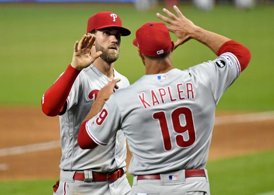Philadelphia Phillies manager Gabe Kapler (right) celebrates after a win with right fielder Bryce Harper (left) against the Miami Marlins at Marlins Park in July.