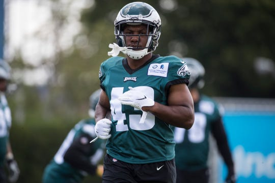 Eagles' Darren Sproles (43) warms up during training camp Thursday at the NovaCare Complex.