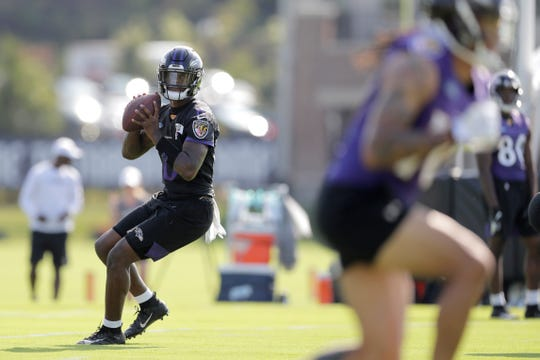 Baltimore Ravens quarterback Lamar Jackson works out during NFL football training camp, Thursday in Owings Mills, Md.