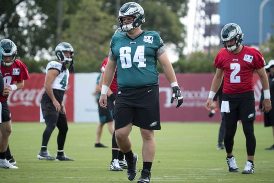 Eagles' Keegan Render (64) warms up during training camp Thursday at the NovaCare Complex.