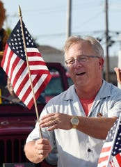 Dewey Beach Mayor T.J. Redefer leads the parade as the Dewey Business Partnership held their Summer Parade on Wednesday evening July 24 along Coastal Highway in Dewey Beach.