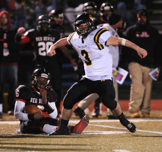Tri-Valley's Austin Jones celebrates a sack against Columbus Marion-Franklin during the Division II, Region 7 finals during a 2011 game at Gahanna. Jones was a two-way star for the Scotties, who made the regional finals for the first time that year.