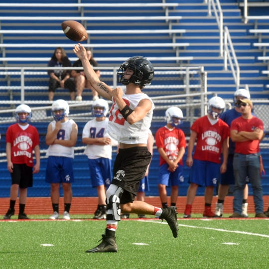 Crooksville quarterback Caden Miller throws a pass during a 7-on-7 passing scrimmage on Wednesday against Lakewood. Miller is finally back after missing almost 11 months with a knee injury.