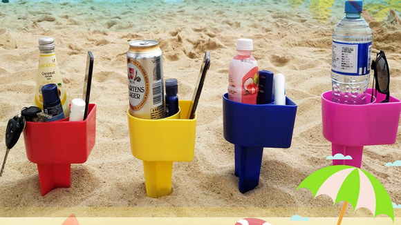 Keep your phone and beverage away from the sand.