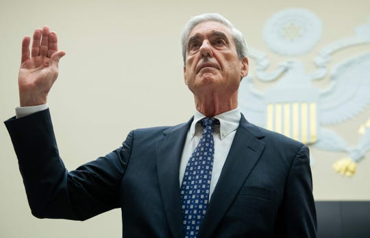 Former Special Counsel Robert Mueller is sworn in for his testimony before the House Select Committee on Intelligence hearing on Capitol Hill in Washington, DC on July 24, 2019.
