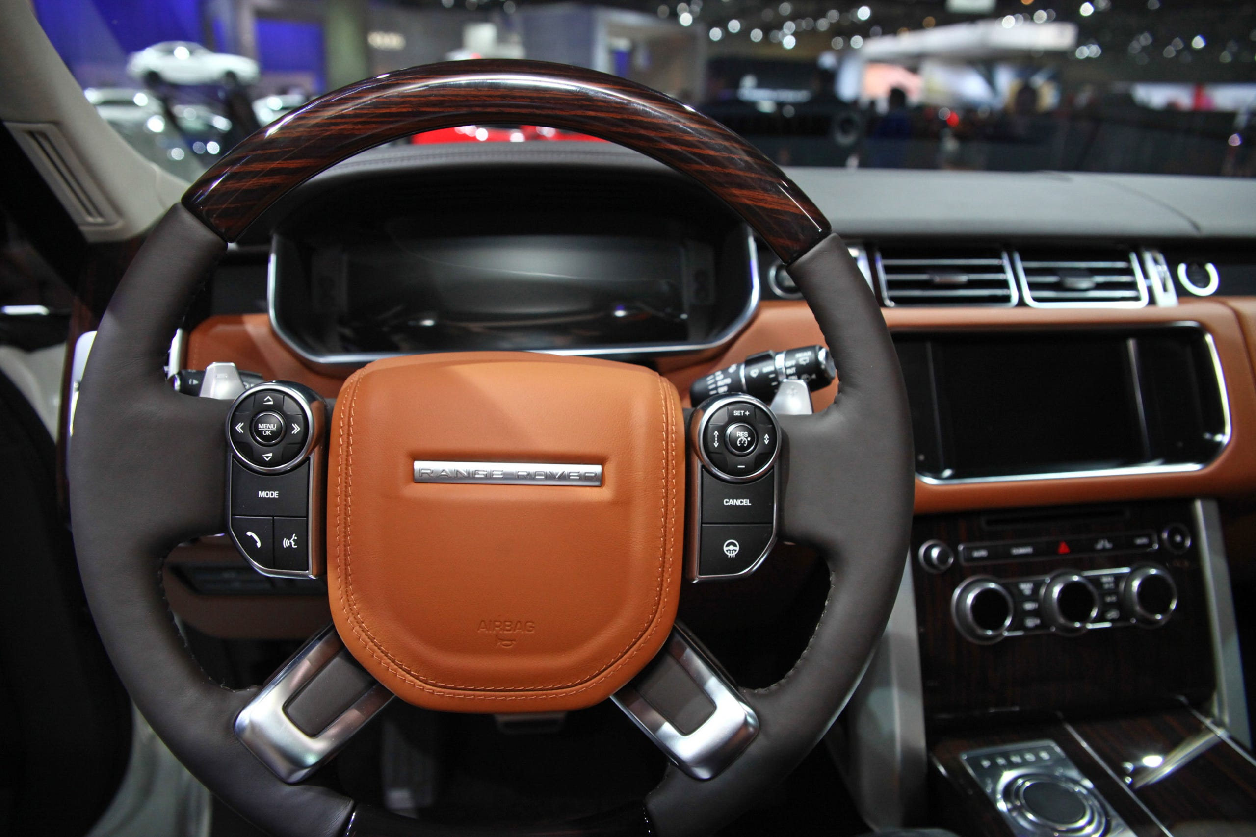 This is the steering wheel and dashboard of the Land Rover Autobiography Black stretch Range Rover.