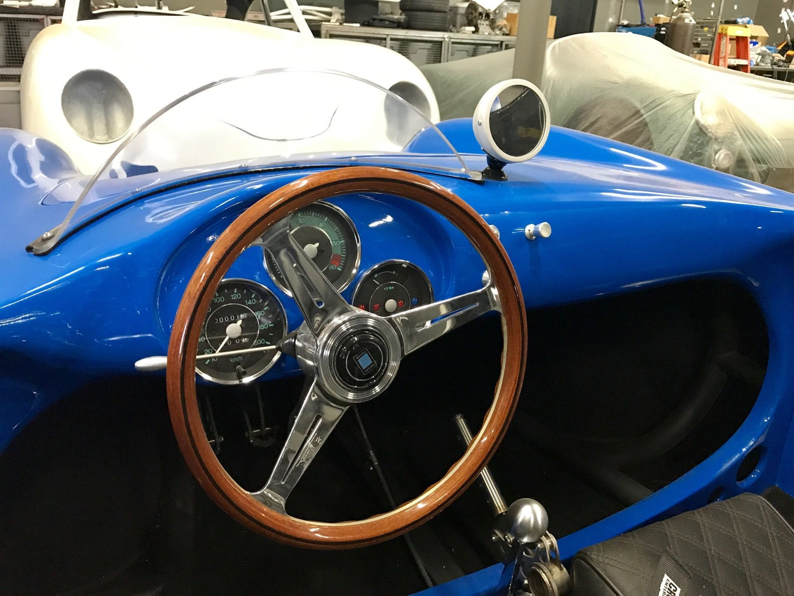 Seduction Motorsports' tribute to the Porsche 550 Spyder includes period-correct touches such as simple gauges, a wooden Nardi steering wheel and a circular rear view mirror.