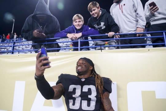 Birmingham Iron running back Trent Richardson takes a selfie with fans after a game against the Atlanta Legends.