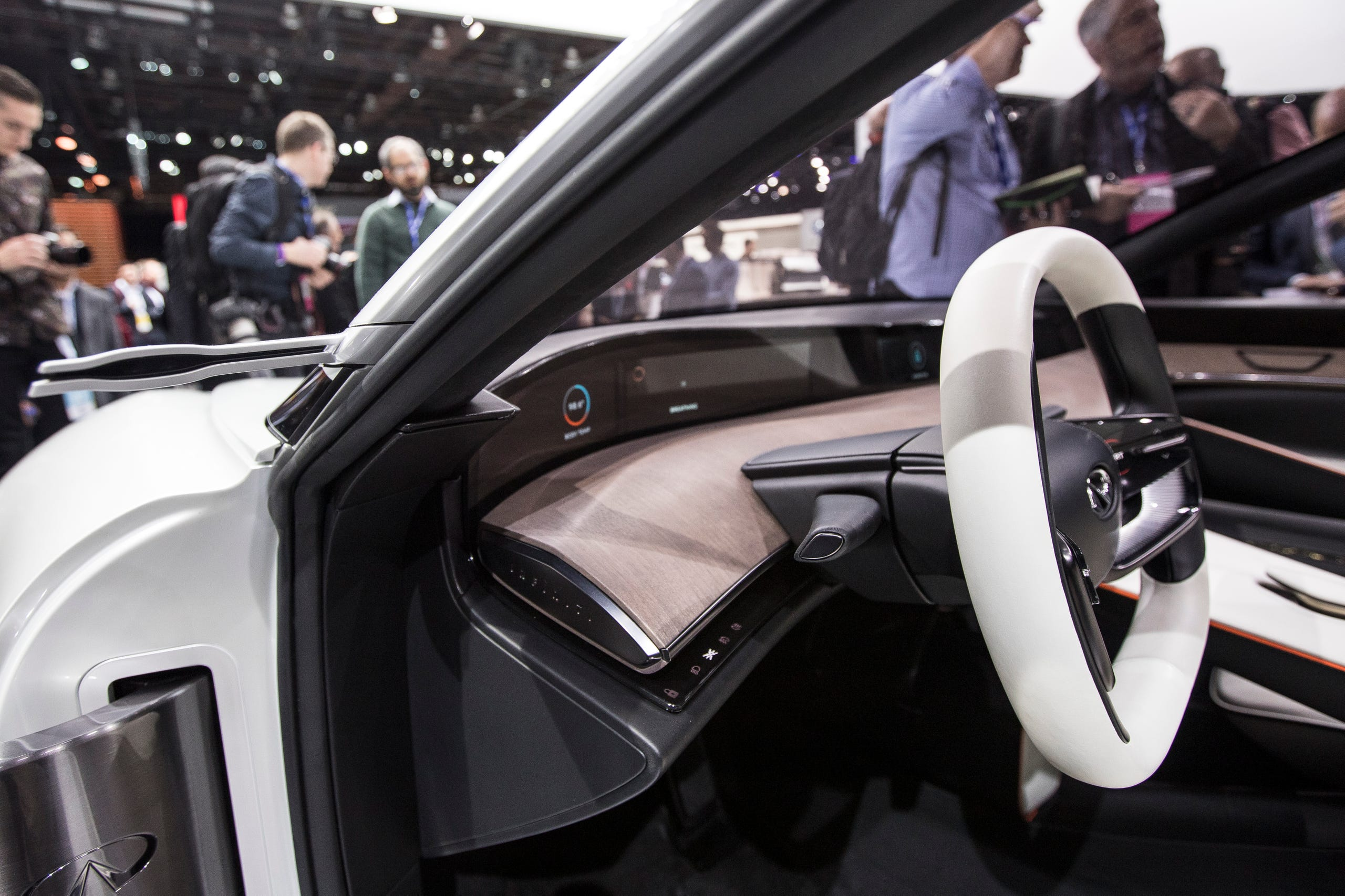 Steering wheel and side mirror of the Infiniti Q Inspiration concept during the 2018 North American International Auto Show held at Cobo Center in downtown Detroit on Monday, Jan. 15, 2018.