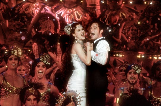 "Nicole Kidman and Ewan McGregor starred in Baz Luhrmann's 2001 jukebox musical ""Moulin Rouge!"""
