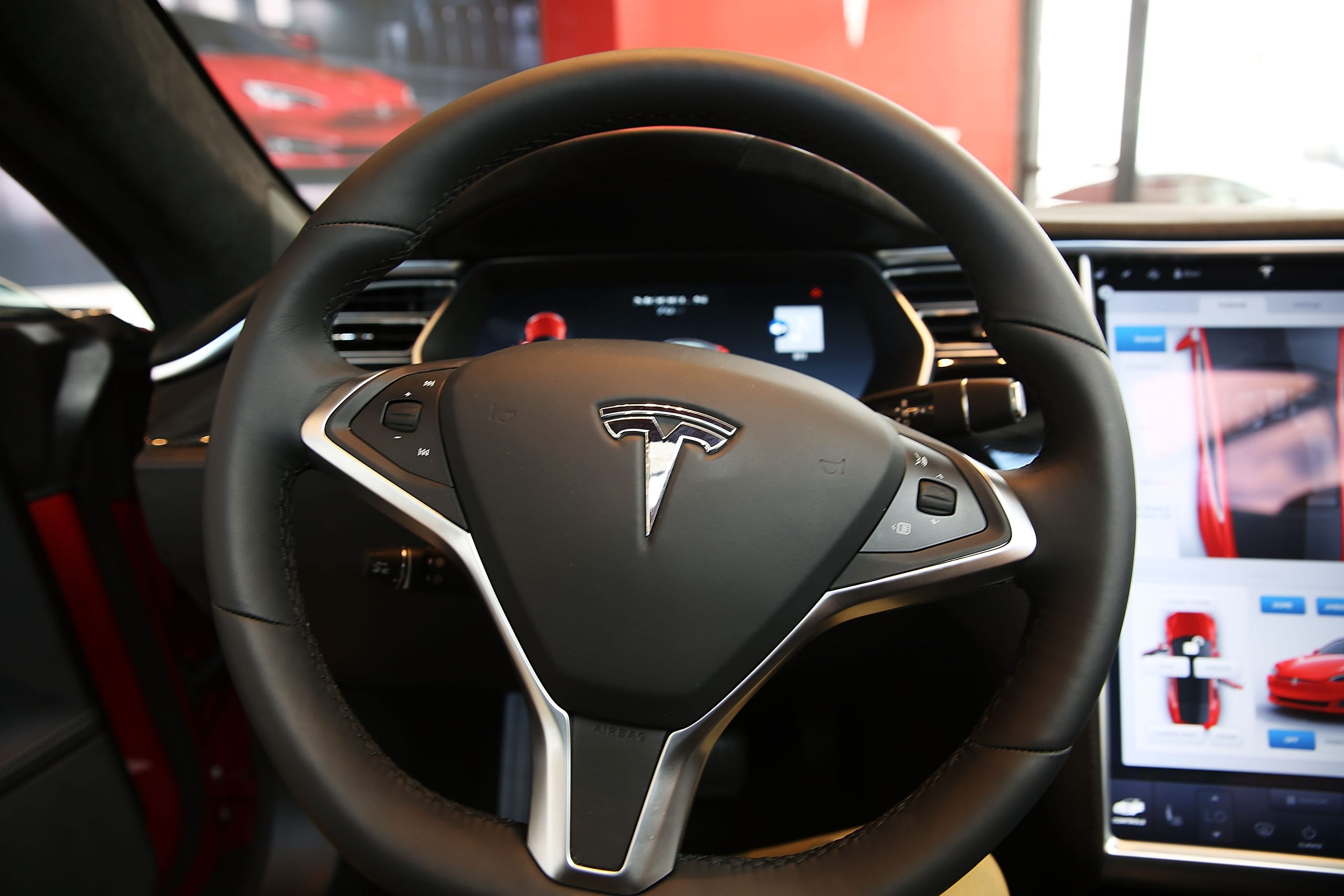 The inside of a Tesla vehicle is viewed as it sits parked in a new Tesla showroom and service center in Red Hook, Brooklyn.