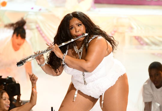 Lizzo, here at the 2019 BET Awards, often plays flute onstage during her shows. She's plays flute on her albums, too.