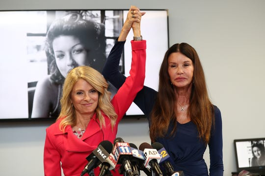 Attorney Lisa Bloom (L) and Janice Dickinson at a press conference to announce a settlement in a defamation lawsuit against Bill Cosby, on July 25, 2019 in Woodland Hills, California.