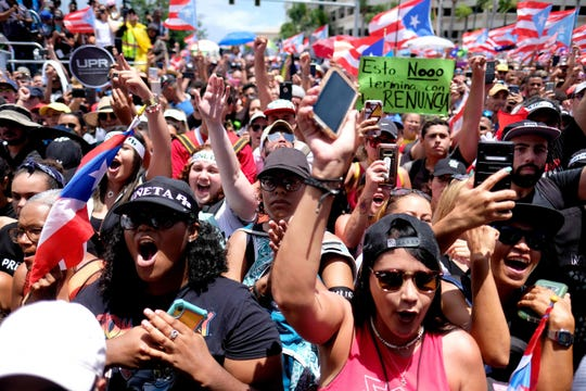 People march in San Juan on July 25, 2019, one day after the resignation of Puerto Rico Governor Ricardo Rossello.
