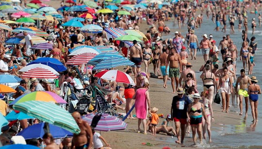 Beachgoers gather at Malvarrosa beach in of Valencia, Spain on July 25, 2019. An extreme heatwave as swept across Europe with temperatures reaching up to 104 degrees Fahrenheit. The record-setting temperatures mark Europe's second major heatwave in just two months.