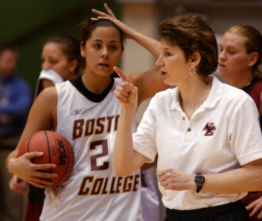 Boston College coach Cathy Inglese, talks with a player during practice in 2004.
