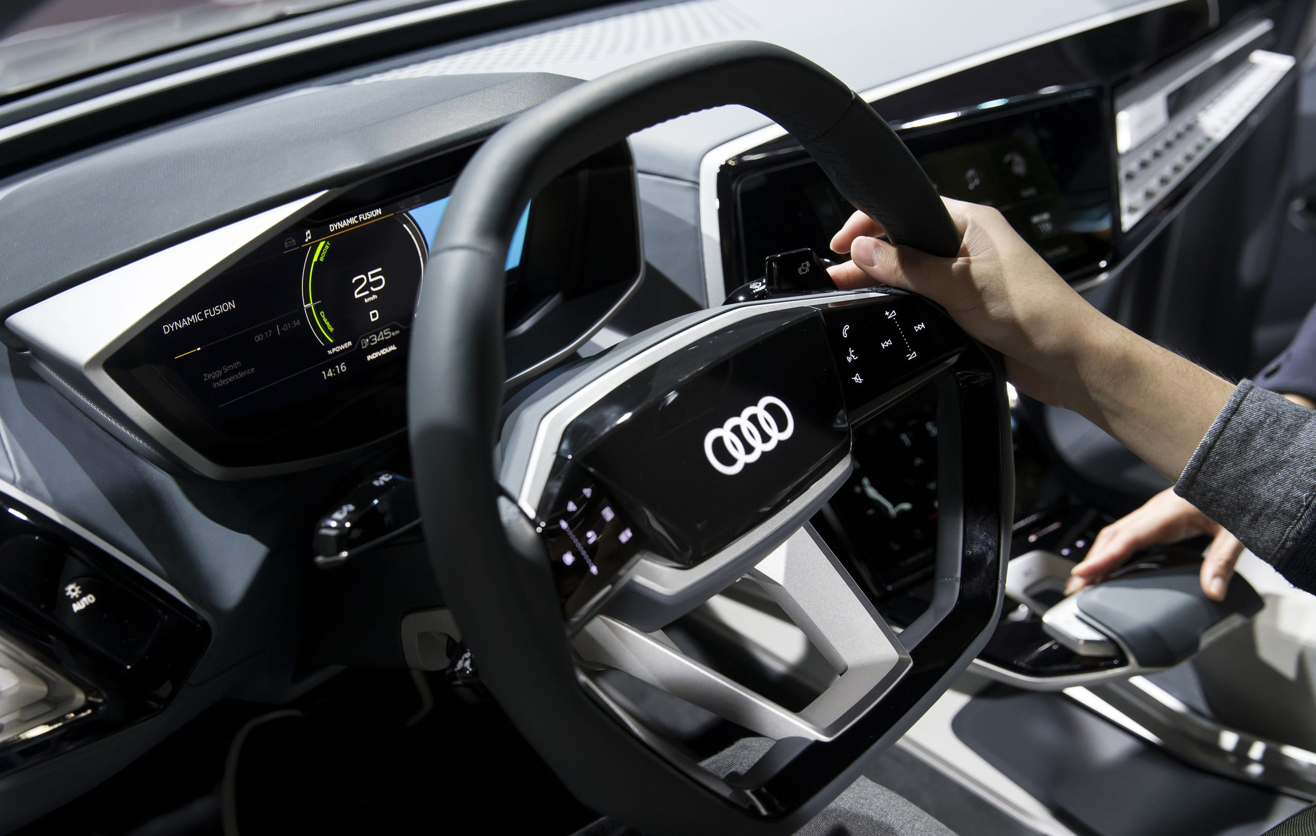 A visitor holds a steering wheel of the Audi Elaine vehicle in the Audi AG booth during the Tokyo Motor Show at Tokyo Big Sight on Oct. 25, 2017 in Tokyo, Japan.