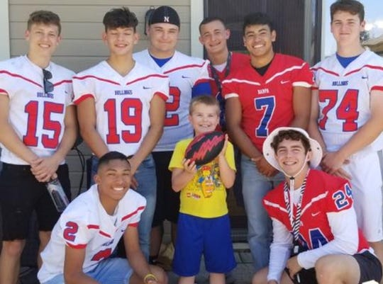 Christian Larsen, 9, said he had the best birthday ever when he received a surprise visit from the Nampa High School football team.