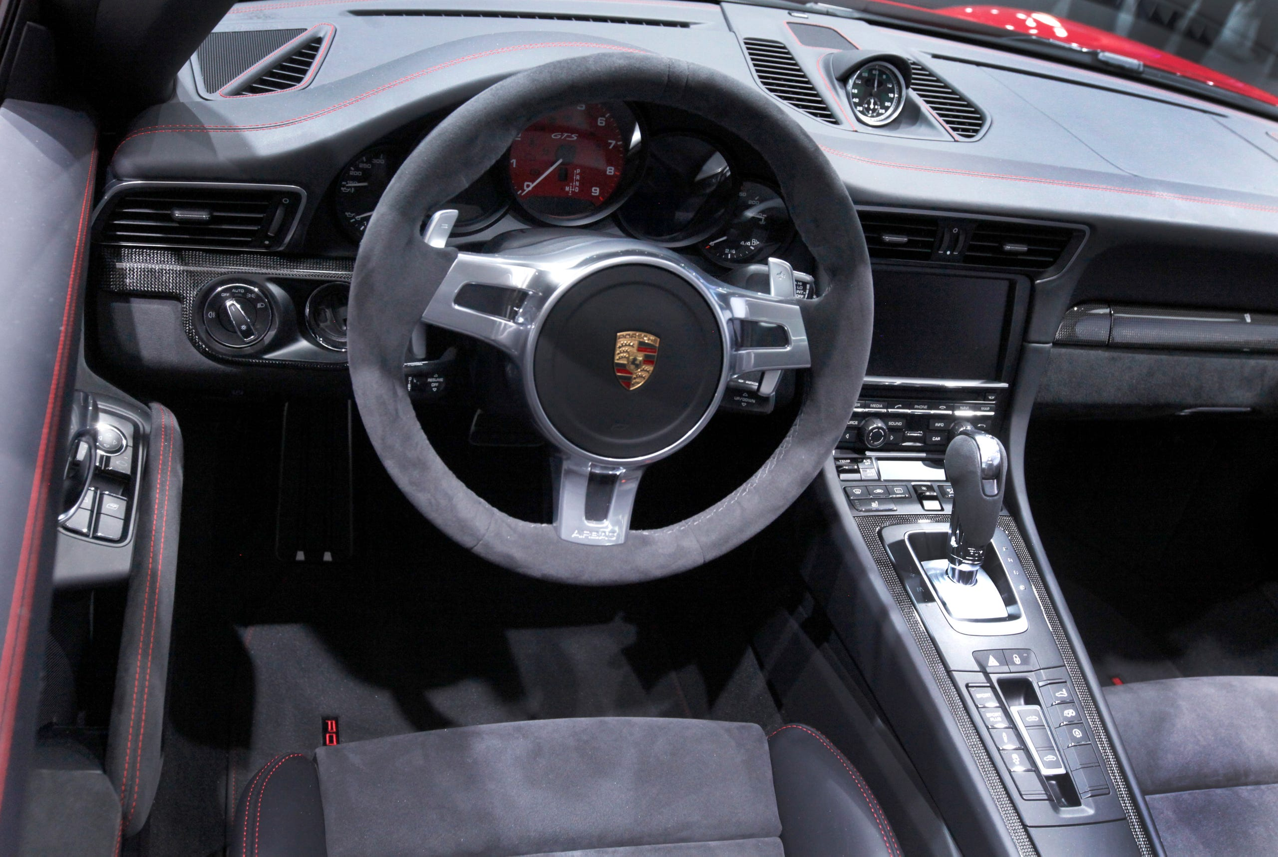 Interior and steering wheel of the Porsche 911 Targa GTS at the 2015 North American International Auto Show at Cobo Center on Monday, Jan. 12, 2015.
