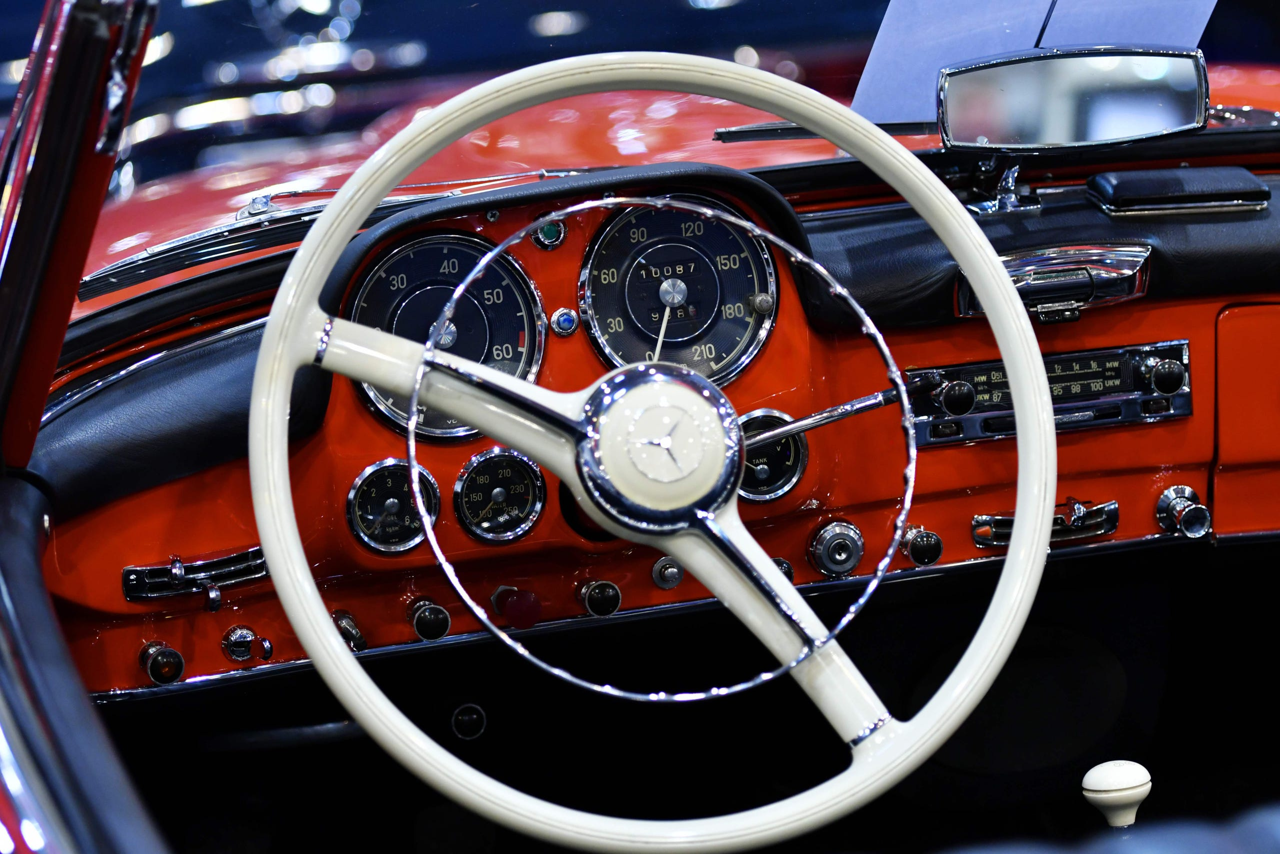 A picture taken on December 1, 2017 shows the steering wheel and the inside of a Mercedes-Benz classic car displayed during the 'Essen Motor Show' fair in Essen, western Germany.