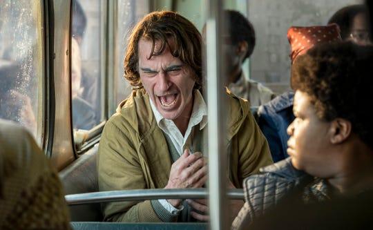 "Joaquin Phoenix's Arthur Fleck is having a terrible bus ride in ""Joker."""