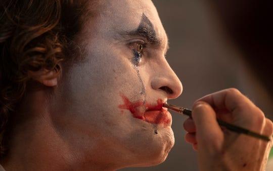 Joaquin Phoenix puts on the makeup in