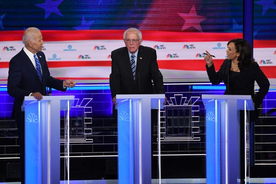 Former Vice President Joe Biden and Sens. Bernie Sanders and Kamala Harris at the Democratic debate in Miami on June 27, 2019.