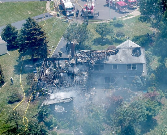 Firefighters are shown at the scene of a house fire at 11 Wilson Court in Manalapan Friday, July 26, 2019.